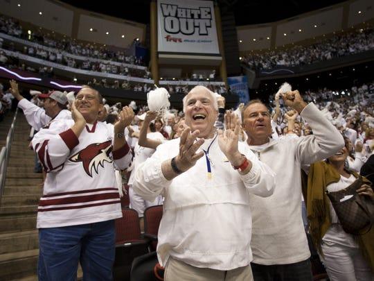 Sen. John McCain (center) celebrates a goal by Shane Doan during the 2012 NHL playoffs at Jobing.com Arena.