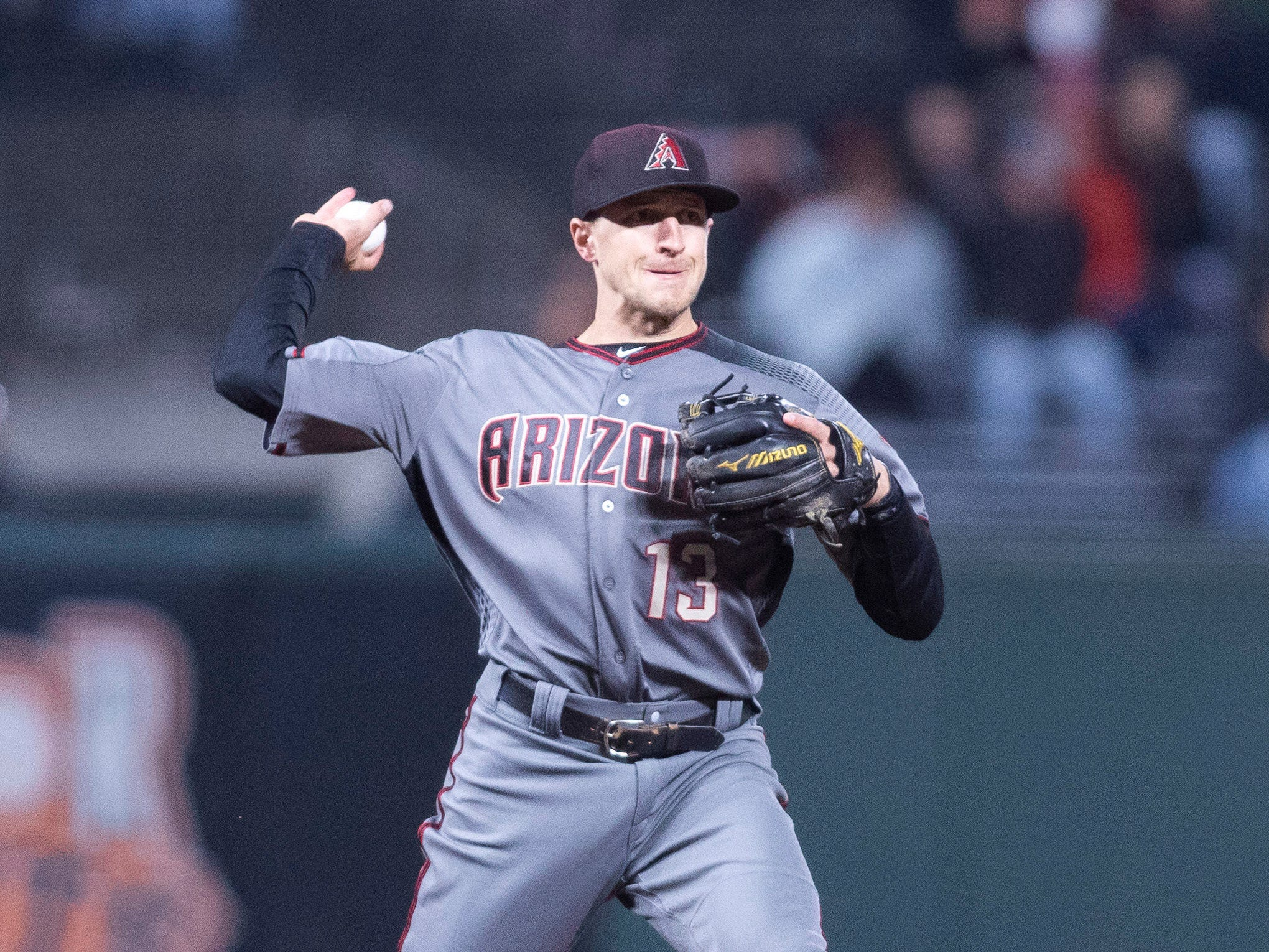 Aug 27, 2018: Arizona Diamondbacks shortstop Nick Ahmed (13) throws to retire San Francisco Giants right fielder Andrew McCutchen (not pictured) during the eighth inning at AT&T Park.