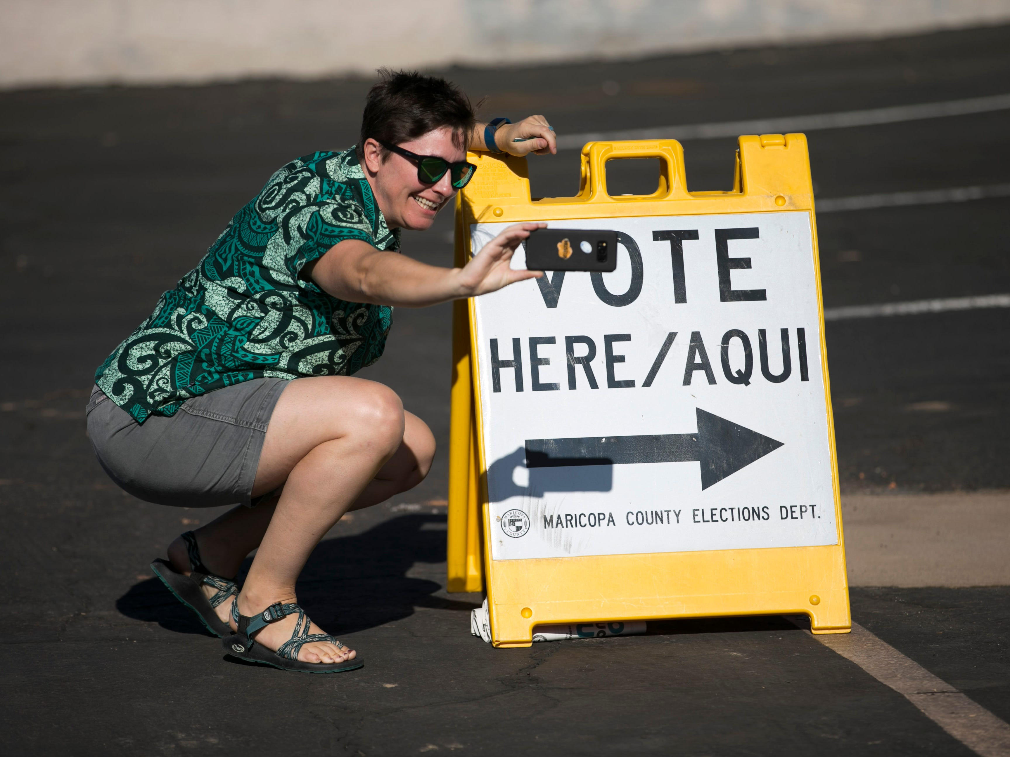 Katie Hinde of Phoenix, takes a selfie after voting for the primary, at the polling place at Memorial Presbyterian Church in Phoenix, Aug. 28, 2018.