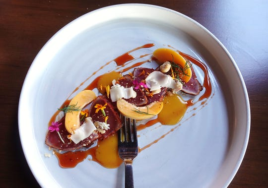 Spiced tuna crudo with apricot, Aperol, toasted hazelnut, lardo de iberico de bellota and rosemary at Talavera in Scottsdale.