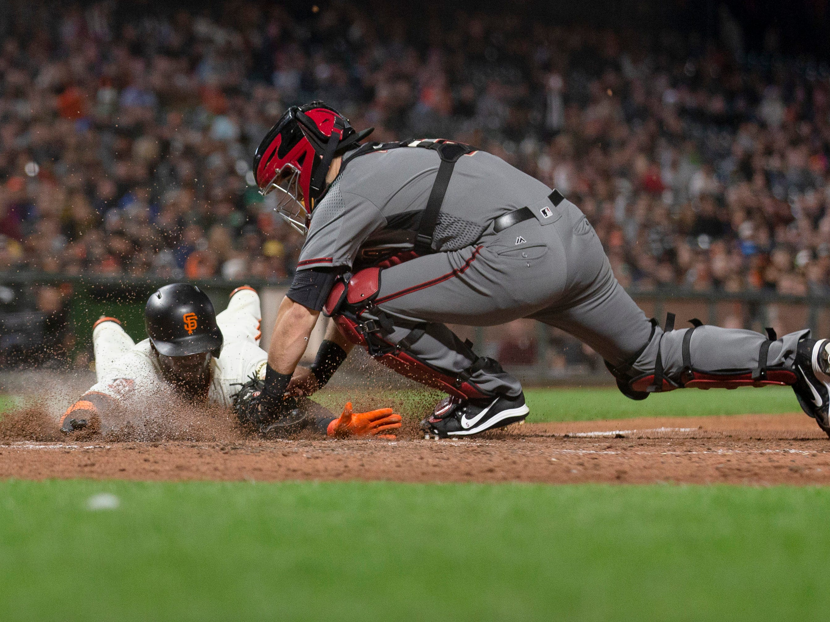 Aug 27, 2018; San Francisco, CA, USA; San Francisco Giants right fielder Andrew McCutchen (22) is tagged out at home plate by Arizona Diamondbacks catcher Alex Avila (5) during the sixth inning at AT&T Park. Mandatory Credit: Neville E. Guard-USA TODAY Sports