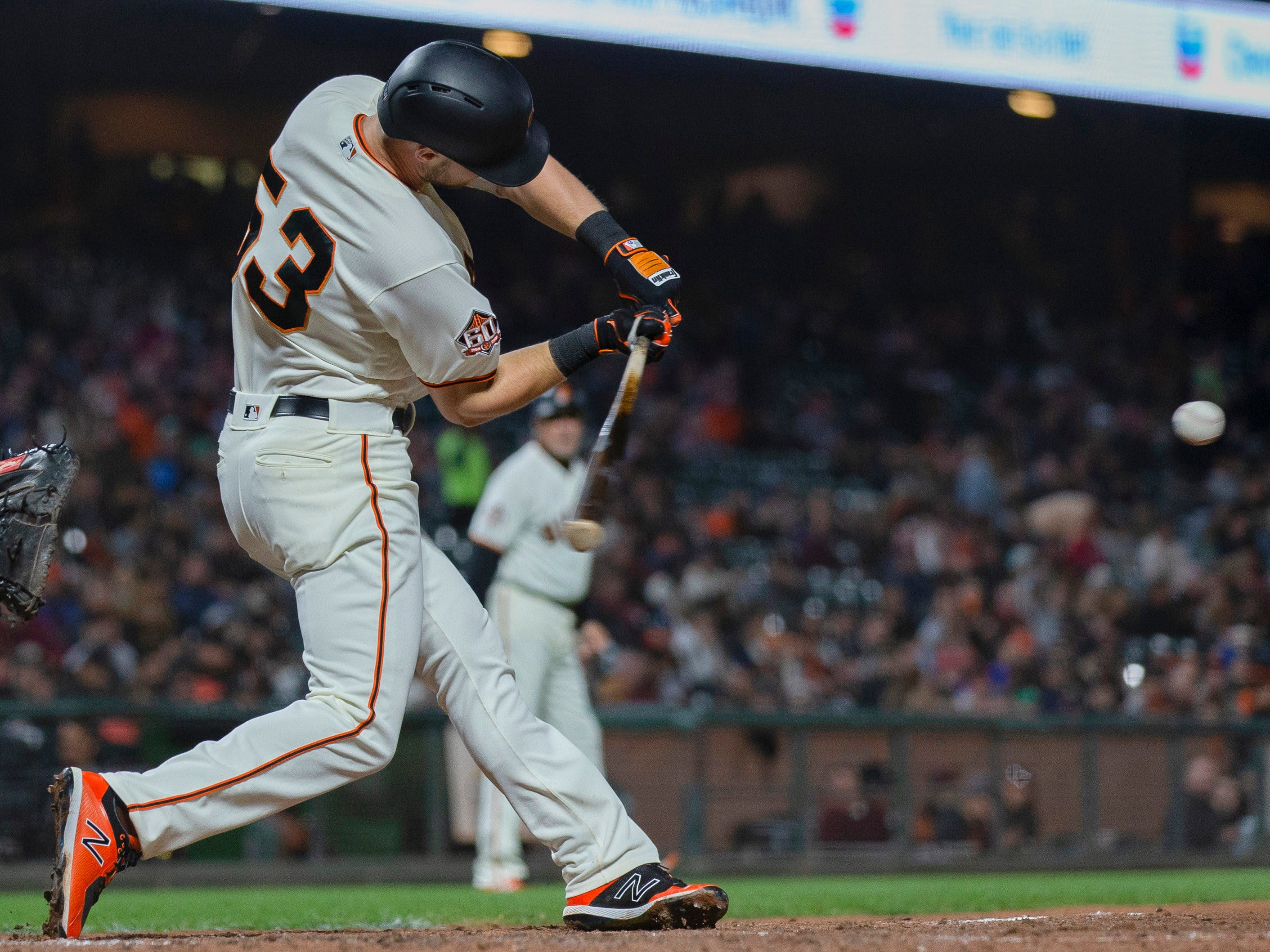 Aug 27, 2018; San Francisco, CA, USA; San Francisco Giants first baseman Austin Slater (53) hits a single during the first inning against the Arizona Diamondbacks at AT&T Park. Mandatory Credit: Neville E. Guard-USA TODAY Sports