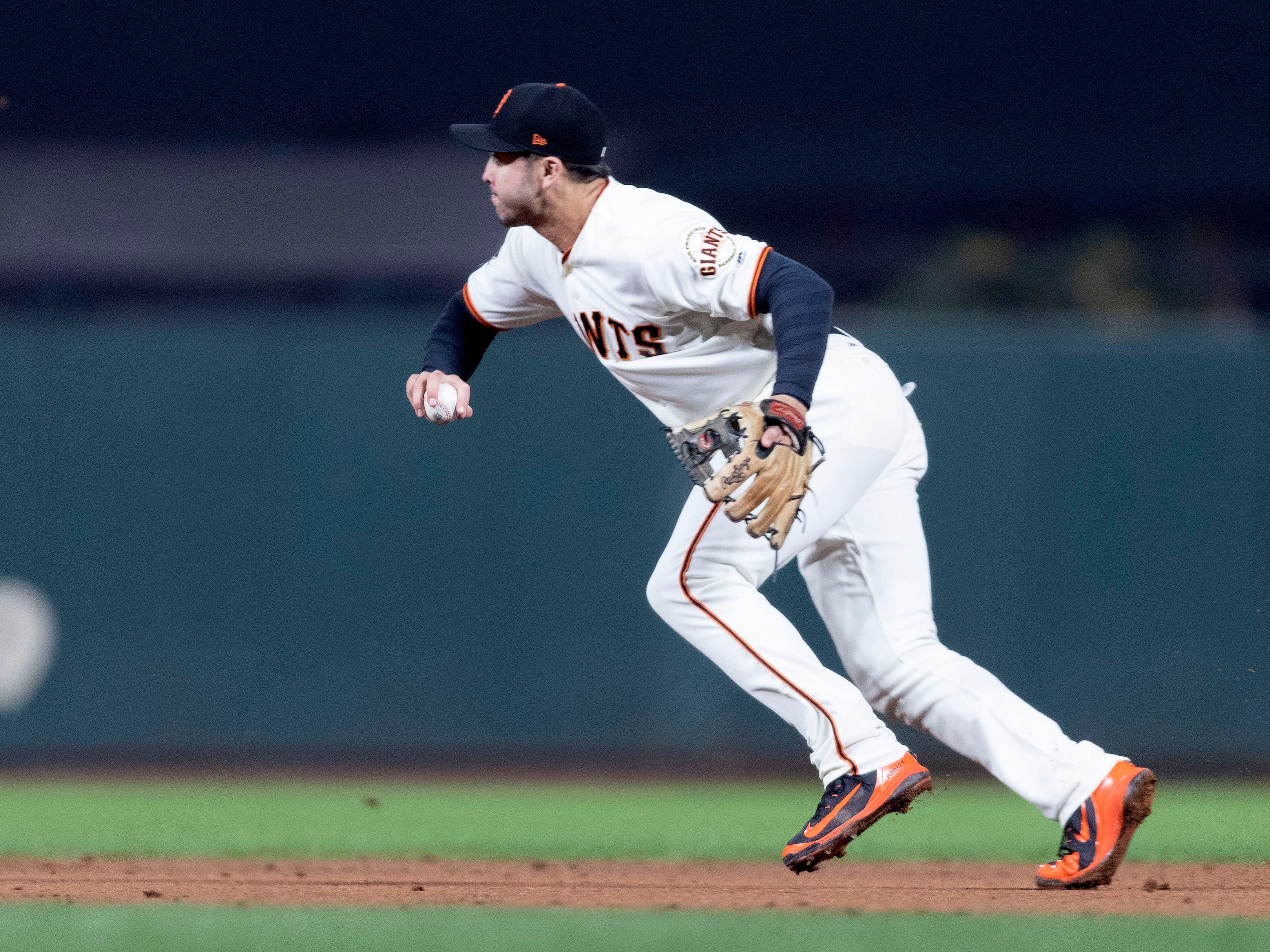 Aug 27, 2018; San Francisco, CA, USA; San Francisco Giants second baseman Chase d'Arnaud (2) throws out Arizona Diamondbacks center fielder Jon Jay (not pictured) during the third inning at AT&T Park. Mandatory Credit: Neville E. Guard-USA TODAY Sports