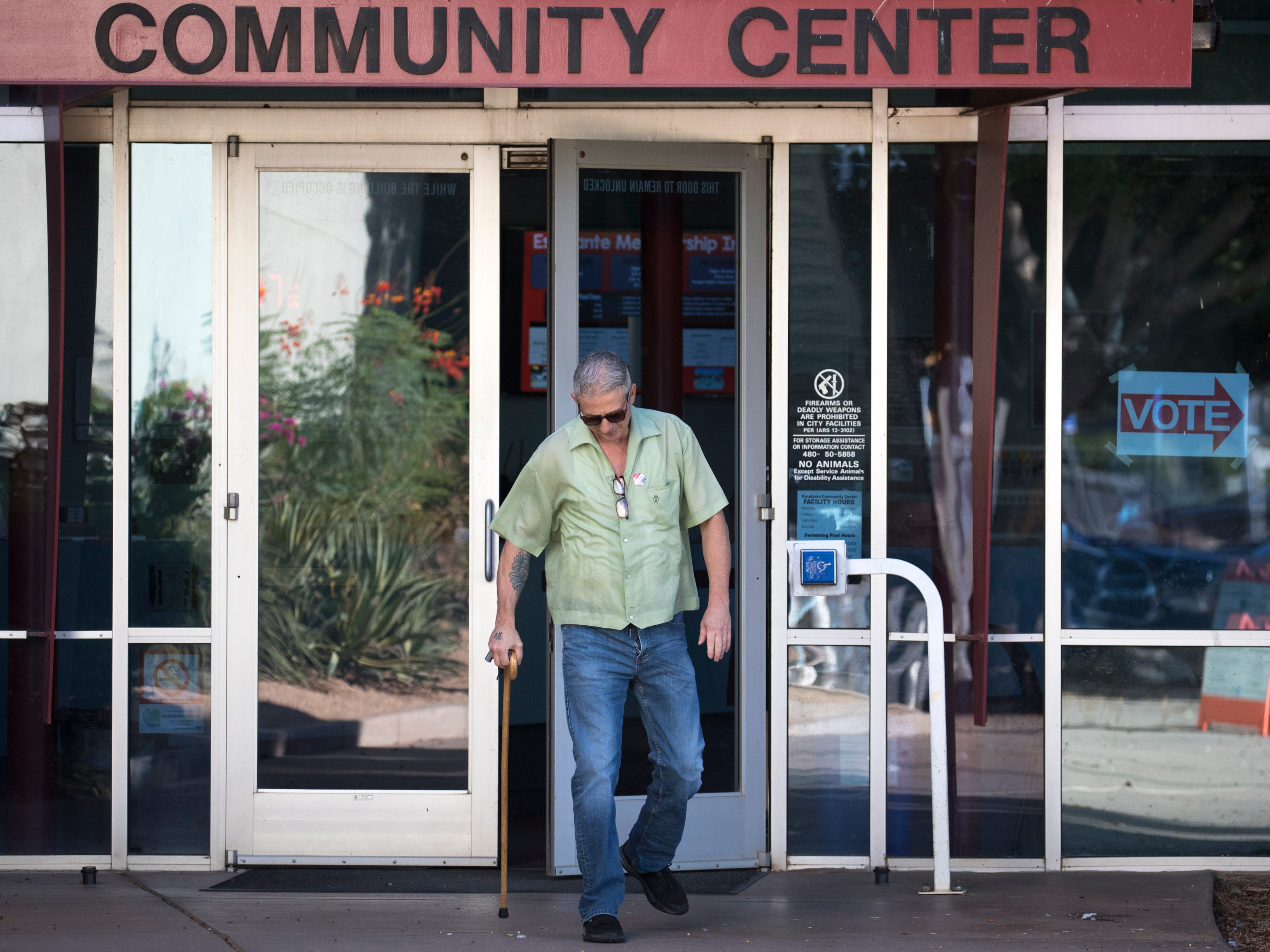 A voter leaves the polling place after casting his ballot, Aug. 28, 2018, at the Escalante Community Center, 2150 E. Orange Street in Tempe.