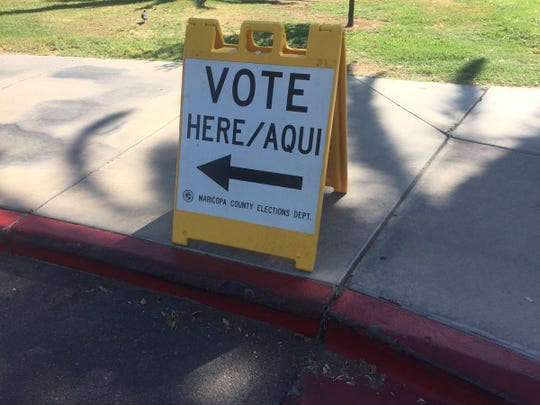 "A sign outside Encanto Park Clubhouse polling location. A Republic reporter on the scene said a man in a silver truck stopped someone at the entrance of the parking lot and yelled, ""The voting machines are down. They say go to Burton Barr Library."""