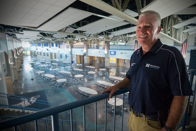 Retired Marysville police officer Tom Cowhy stands on the second floor of the Marysville High School common area Tuesday, Aug. 28, 2018. Marysville hired Cowhy as a school security specialist to replace its school resource officer.