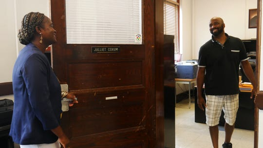 Warring Elementary School Principal Julliet Coxum greets Shawn Cheatham, a micro-computer technician in the Poughkeepsie City School District, in her office on Aug. 28, 2018.