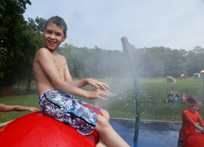 James Sandford of Wappingers Falls plays in the sprinkler park at Bowdoin Park on August 28, 2018.