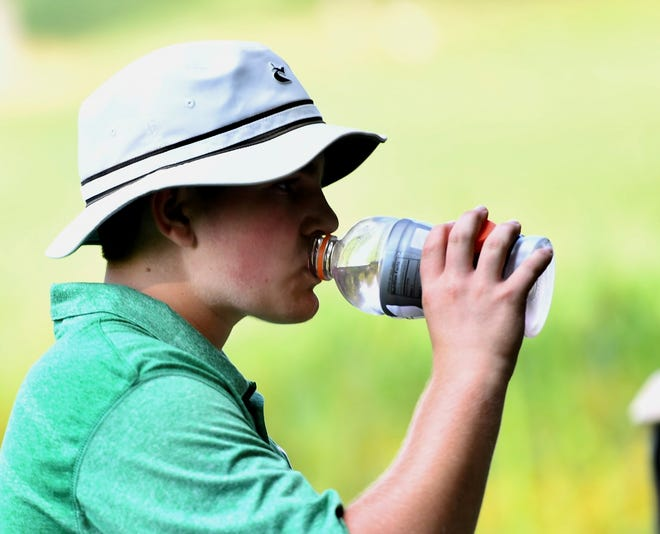 York Catholic's Russell McPaul cools off with a drink of water Tuesday, Aug. 28, 2018, after the 15th hole at Regents Glen County Club in Spring Garden Township. He was playing in a York-Adams Division III golf tournament during a heat advisory. Dawn J. Sagert photo