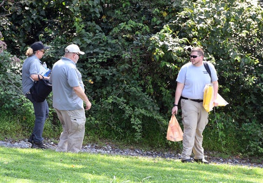 Northeastern Regional Police and the coroner's office investigate a body found in the Codorus Creek along the Starview Sportsmen's Association  property, Tuesday, Aug. 28, 2018.  John A. Pavoncello photo