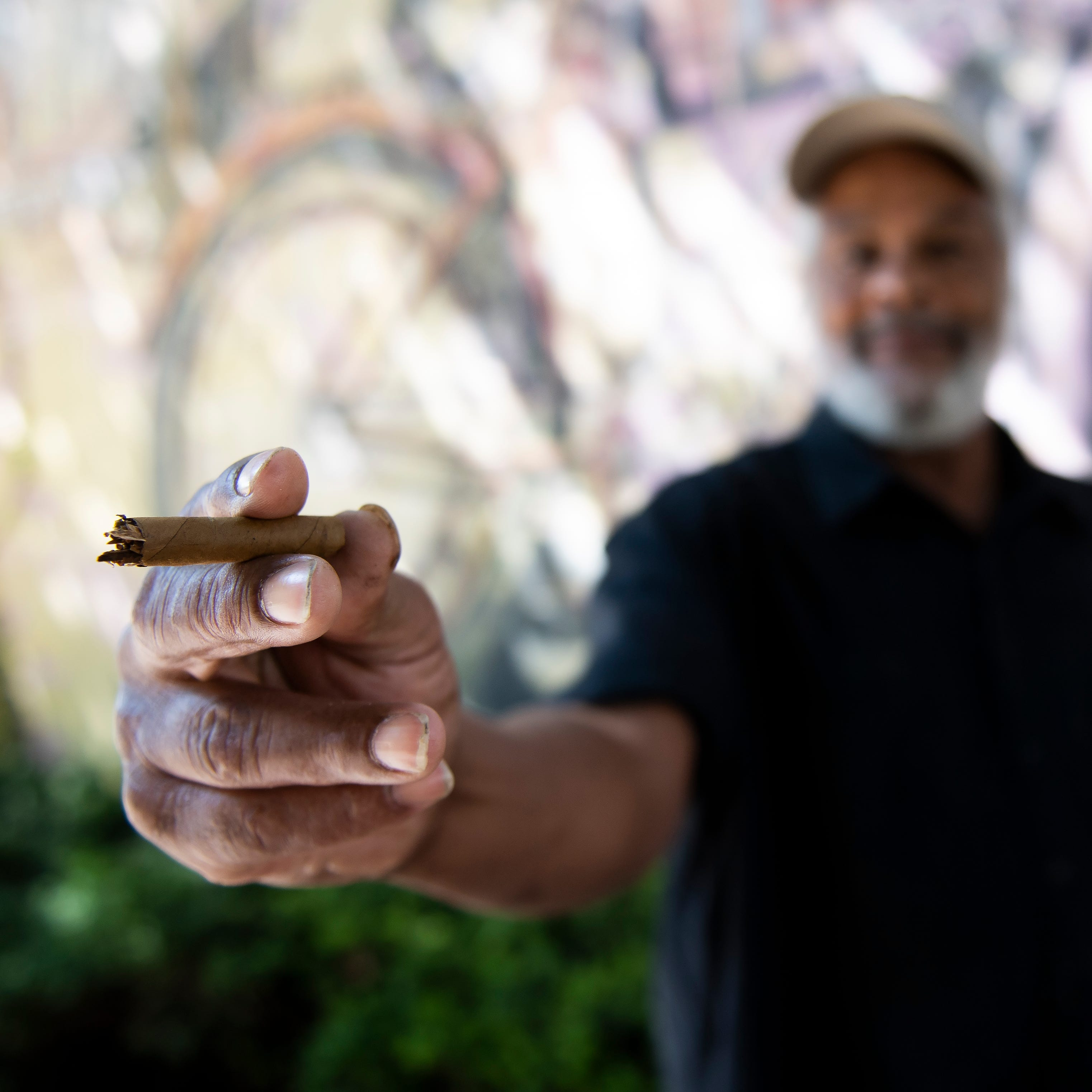 Michael Autry Sr. holds out a piece of a cigar to show how big he remembers the marijuana blunt was that was behind his ear when he was arrested in an alley off West Market Street in York.