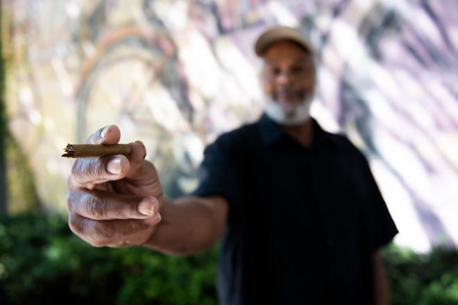 Mike Autry, 59, of York, holds out a piece of a cigar to show how big he remembers the marijuana blunt was that was behind his ear when he was arrested in an alley off West Market Street. He lost his driver's license for one year.