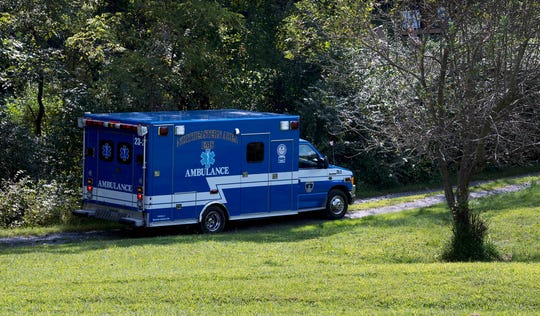 An ambulance stages near the scene on the Codorus Creek near Jerusalem School Road in East Manchester Township where a body was found by two kayakers.