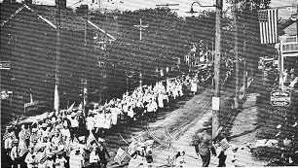 This photo, showing the KKKK marching in a York Haven parade with a cross (top center), comes from an undated borough history book.