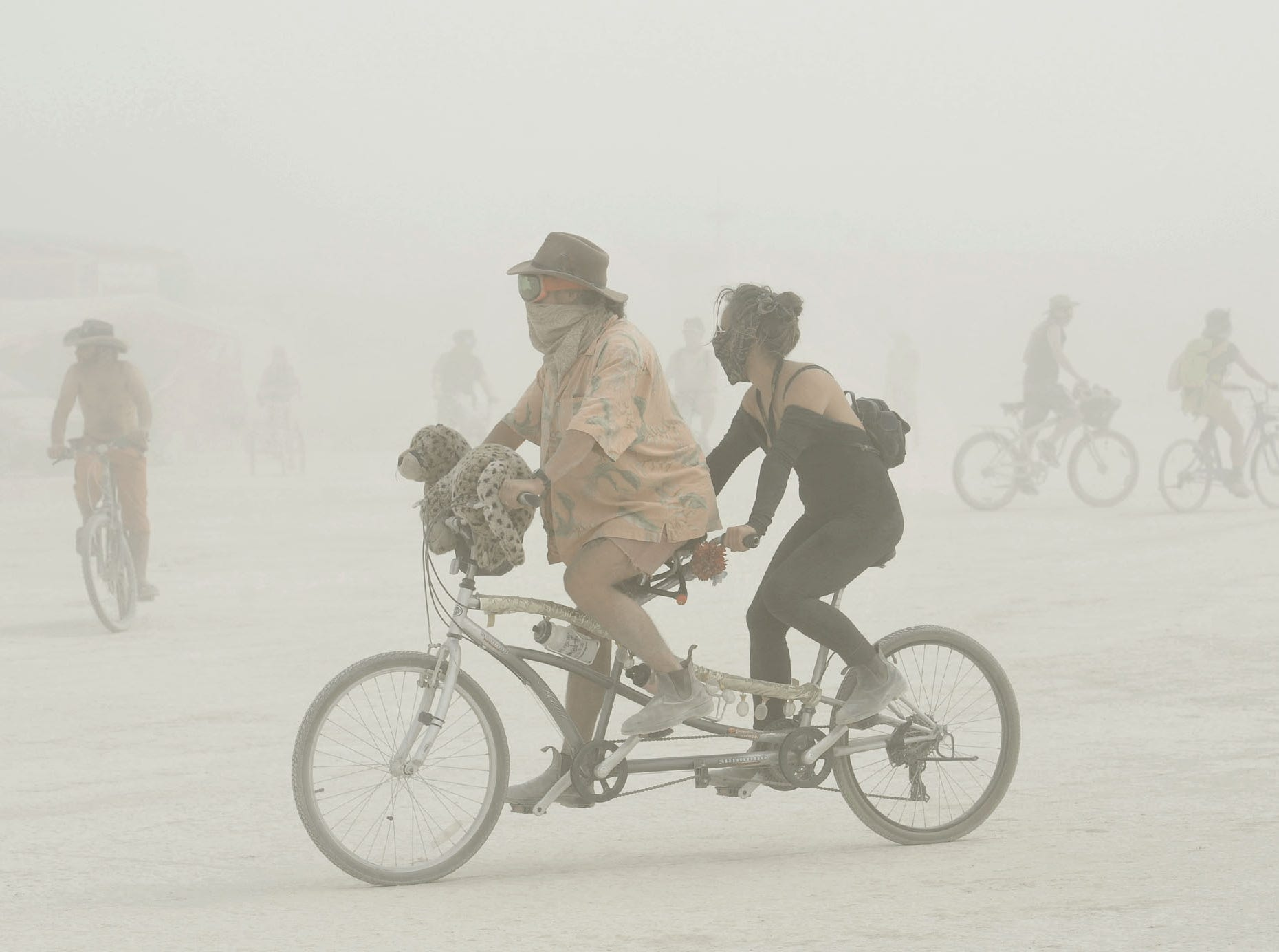 Sunday's dust storm didn't keep Burners from getting out on the playa at Burning Man on Sunday, Aug. 26, 2018. The storm lasted all day, causing the gates into the event to close while the storm lasted.