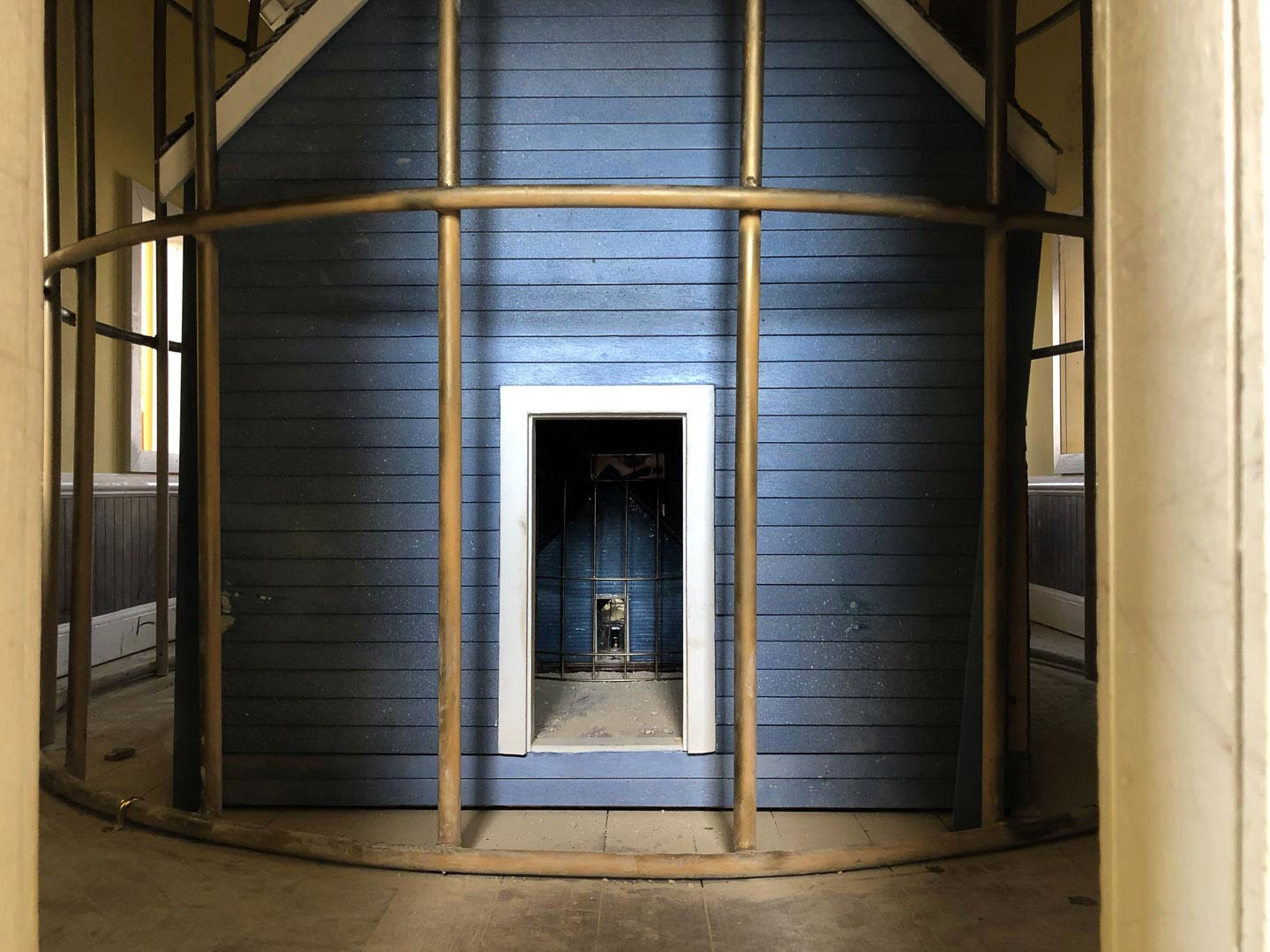 """""""Singularity"""" is a broken bird cage on the playa at Burning Man 2018. It has a house within a house within a house within a house within a house by Rebekah Waites and the Singularity Crew. People can walk inside and interact with the vintage elements, then walk inside the house again and find the same pieces until they can no longer enter the smallest house within."""