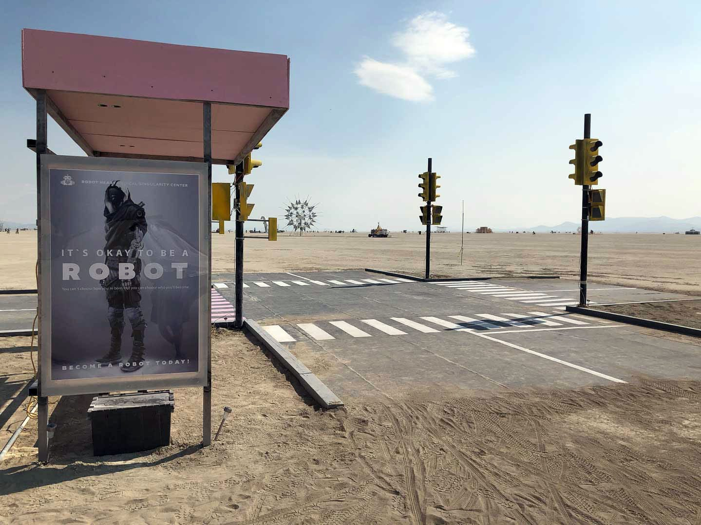A fully recreated intersection with bus stop was built on the playa at Burning Man 2018.