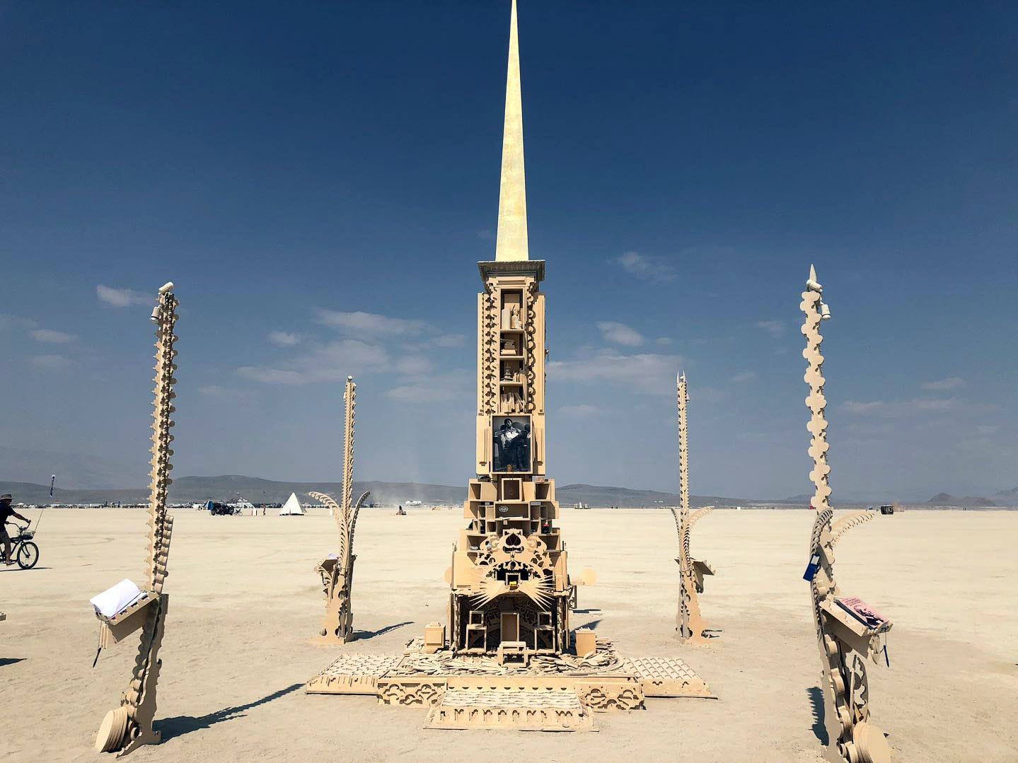 A small temple to Larry Harvey was erected near the large Galaxia temple in the playa at Burning Man 2018. Burners have been writing notes and leaving personal items on the temple shelves.