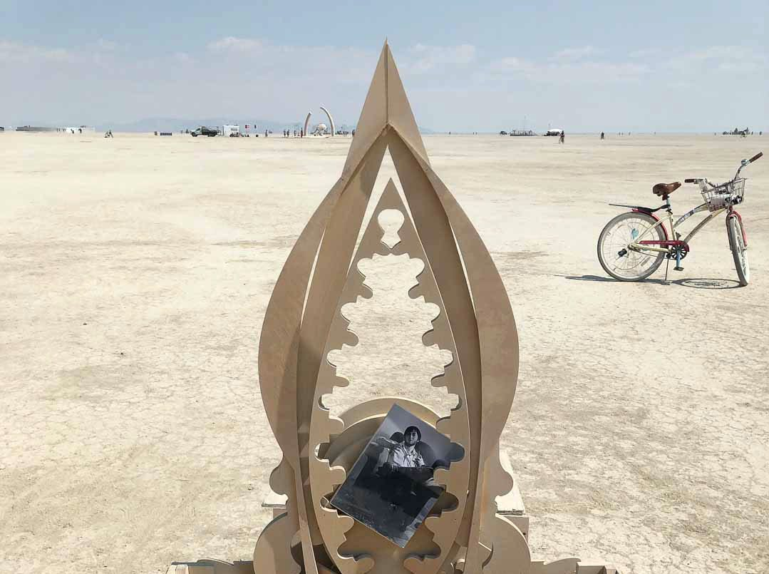A small temple to Larry Harvey was erected near the large Galaxia temple in the playa at Burning Man 2018.