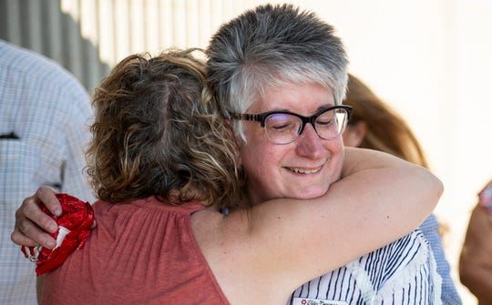 Elder-Beerman store manager Merrie Nunnally receives a hug following the store's closure on Tuesday, Aug. 28, 2018.