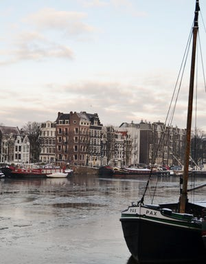 "Eileen H. Anderson: ""The River Amstel in Amsterdam.  I am what I call an 'Accidental Photographer"" (I figure if I take enough pictures with my Nikon D3100 some are bound to turn out okay!)"""