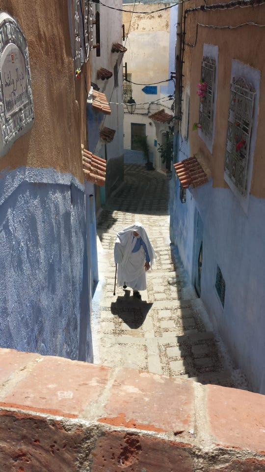 """Paula Silvestrone: """"The whole town of Chefchaouen, Morocco, is set on a steep hill, and almost all buildings are painted turquoise. I was amazed at how elderly and infirm people made their way around town."""" Paula Silvestrone was executive director of AIDS Rochester for 20 years and now enjoys world travel."""