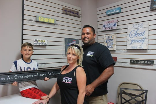 The new Reclaimed DIY Studio in Webster is one of three new art-themed shops to open in the village this summer. It's owned by Tracy Brucato and David Zoyack, shown with David's son Kolton.