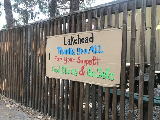 A sign outside Basshole Brews in Lakehead thanks first responders as the Hirz Fire continues to burn nearby on Monday, Aug. 27, 2018.