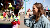 Statesman Journal entertainment reporter Abby Luschei tries to win carnival games at the Oregon State Fair in Salem on Tuesday, Aug. 28, 2018.