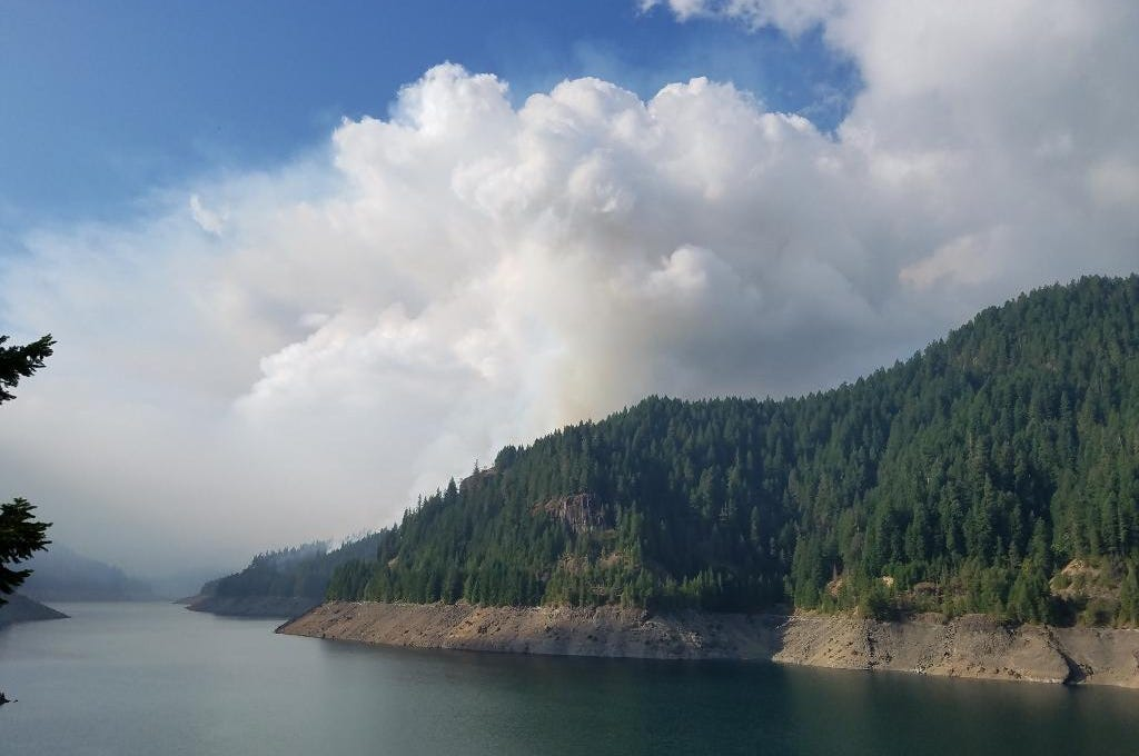 Smoke rises from the Basalt Creek drainage on August 26 from the Terwilliger Fire.
