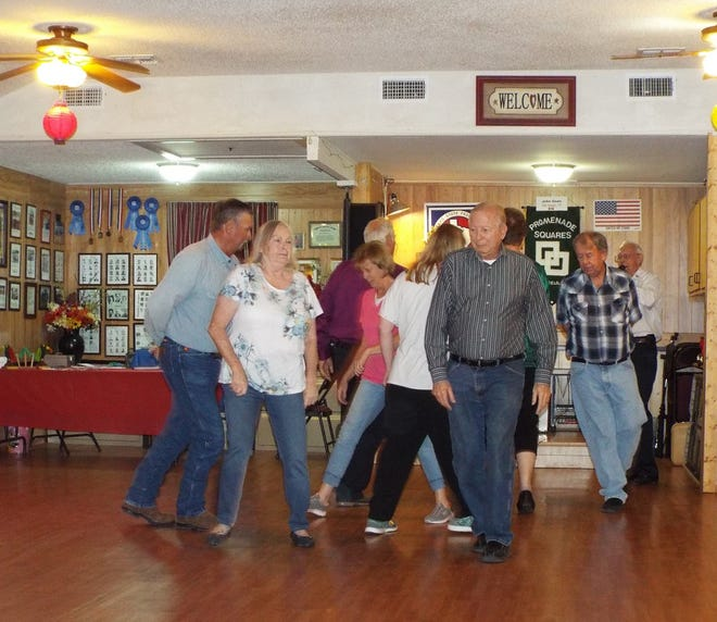 Local dancers perform a routine at Promenade Square, 618 Locust St, where an open house to demonstrate square dance will be held at 7 p.m. Sept. 11. The public is invited to attend.