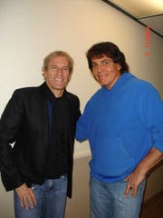 Michael Bolton and Doug James pose in Atlantic City in 2011.