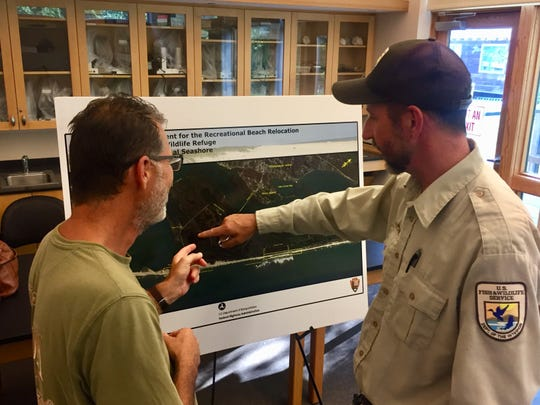 Bob Leffen, deputy refuge manager of Chincoteague National Wildlife Refuge, (right) explains a proposal to resident during a informational session on Monday, Aug. 27, 2018.