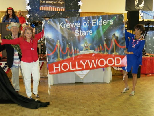 Pat Stell (far left) and others announce with aplomb  Krewe Elders ball theme.