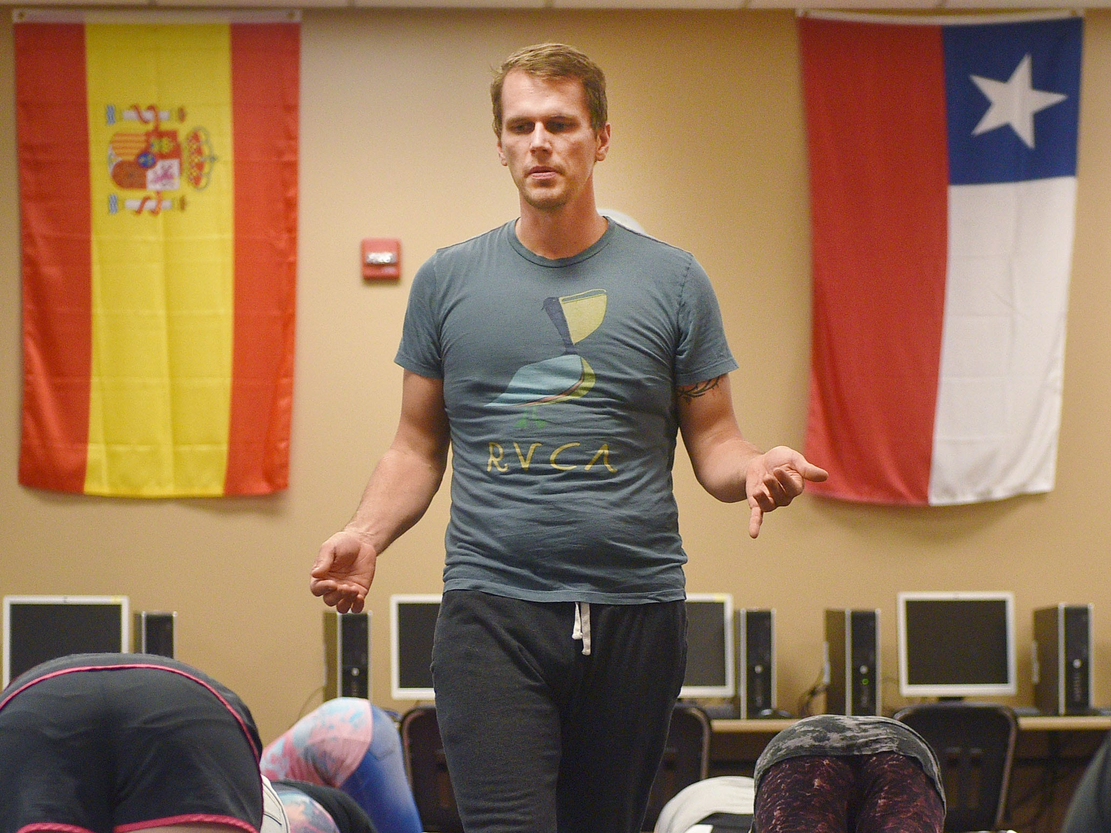 New Tech High School teacher Chris Coughlin instructs a yoga class Tuesday, Aug 28, in Sioux Falls. The class has been added as an extra curricular.