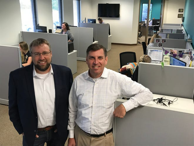 Herk Christie, Expansion Capital Group vice president of operations, and Tim Mages, chief finance officer, stand in their company's Sioux Falls office.