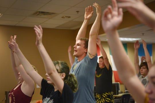 New Tech High School teacher Chris Coughlin instructs a yoga class Tuesday, Aug 28, in Sioux Falls. The class has been added as an extra curricular.