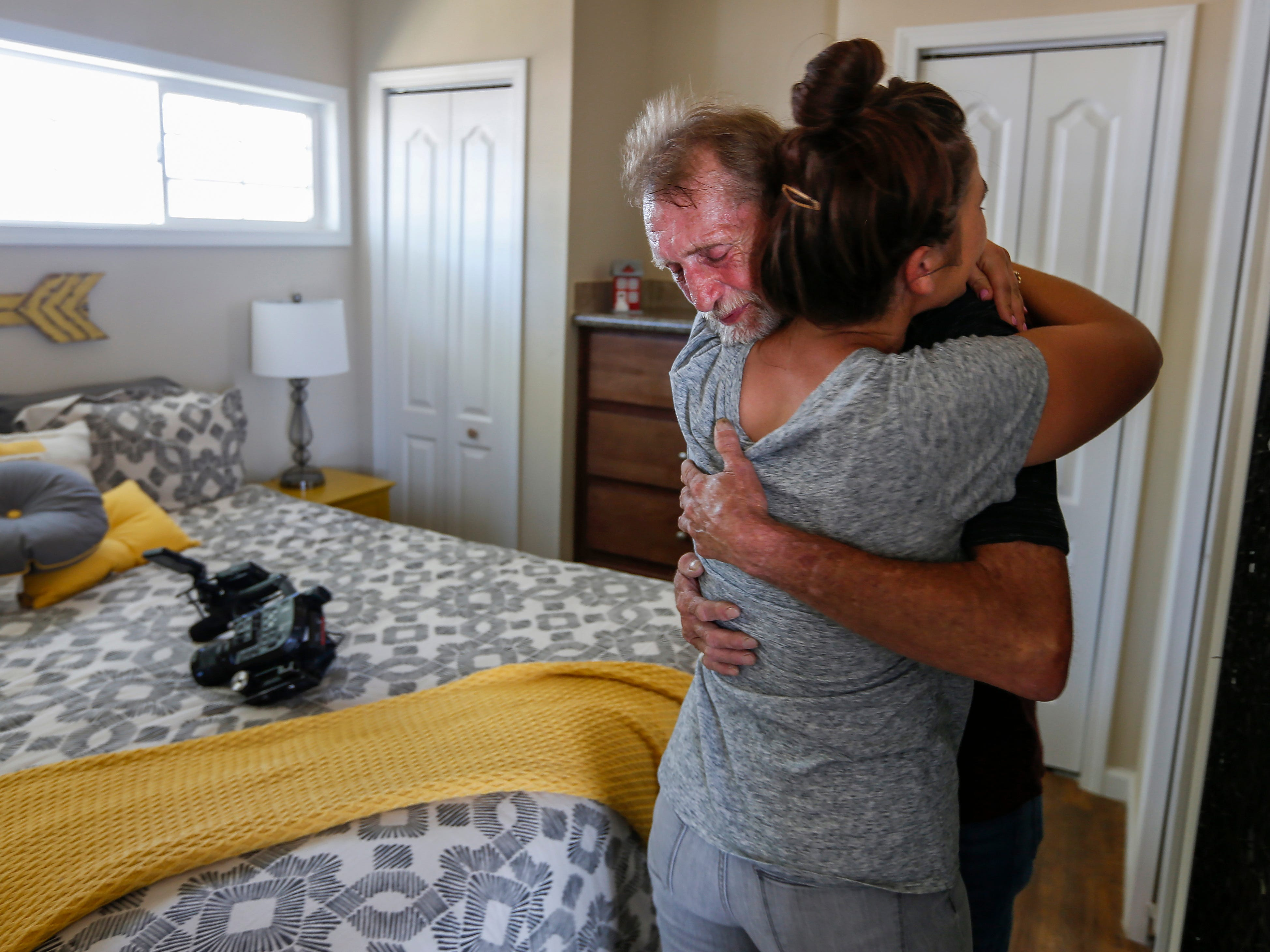 Tommy Yarberry hugs Ashlyn Klingensmith in the bedroom of his new home during the Eden Village Grand Opening Ceremony on Tuesday, Aug. 28, 2018. Yarberry is the first resident to move into the tiny home community.
