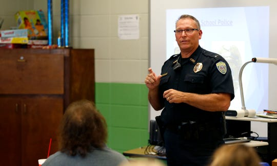 Springfield School Police Department Officer Eric Boxberger leads an ALICE training, Alert-Lockdown-Inform-Counter-Evacuate, course for teachers and administrators at Robberson Elementary School on Tuesday, Aug. 28, 2018.