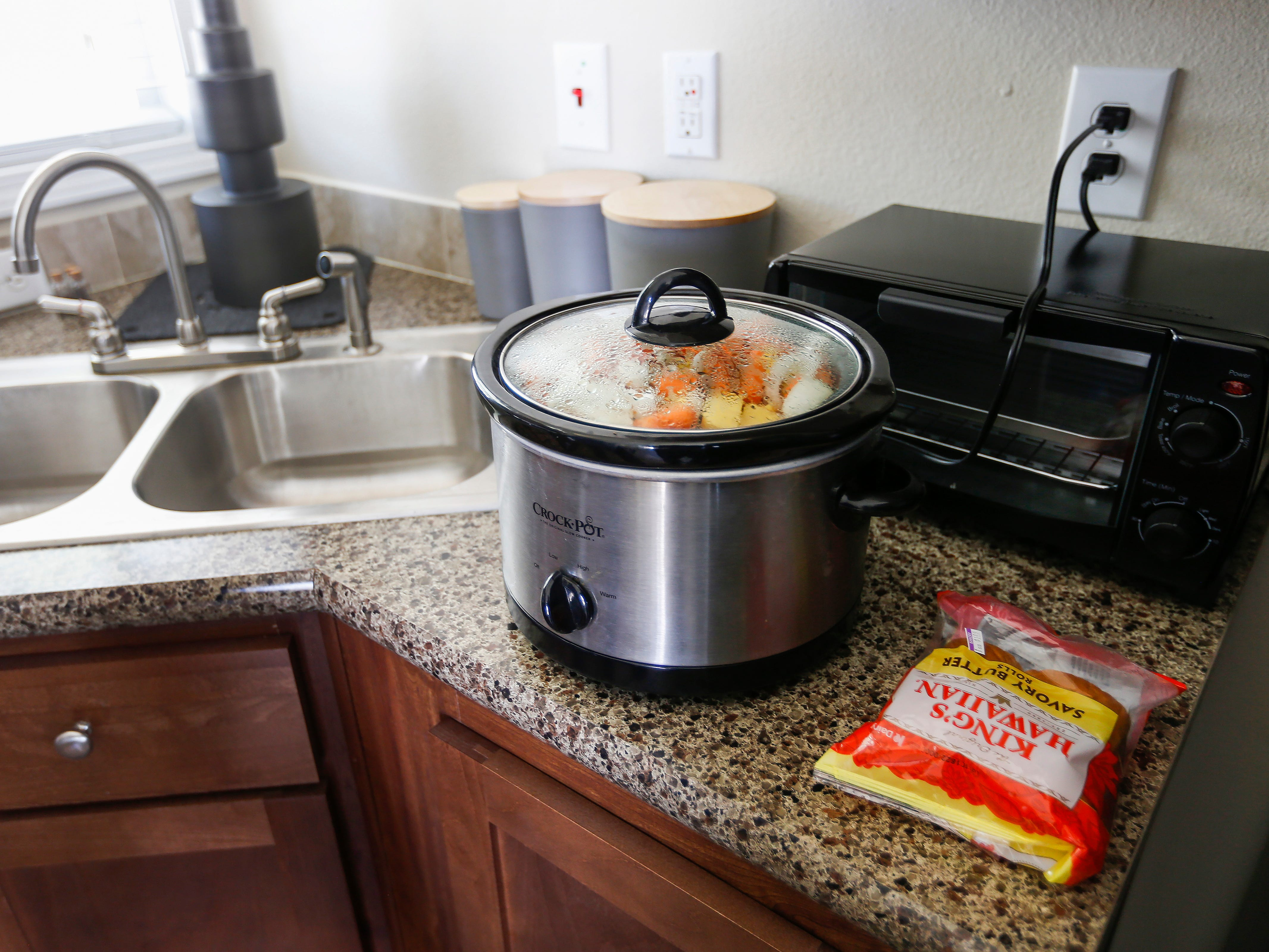 Tommy Yarberry, the first resident to move into Eden Village, was welcomed with a pot roast cooking in his slow cooker during the Grand Opening Ceremony at Eden Village on Tuesday, Aug. 28, 2018.