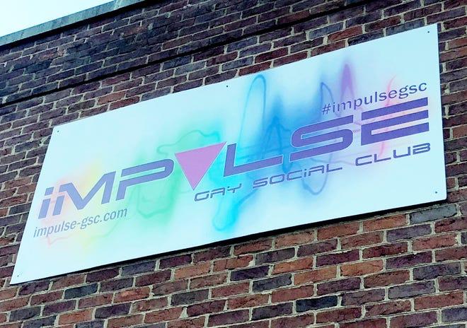 Impulse Gay Social Club sign in Charlottesville.