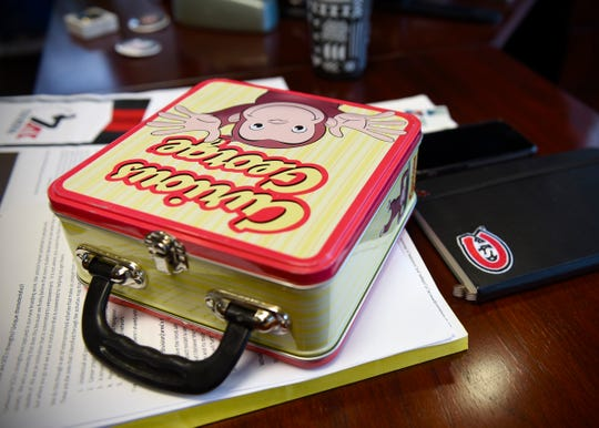 St. Cloud State University President Robbyn Wacker brings her lunch in a Curious George lunch box Tuesday, Aug. 28, in her office. She likes the character for his curiosity and his little bit of mischief.