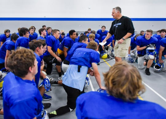 Foley coach Dave Dahlstrom talks with players during a break Monday, Aug. 20, at Foley High School.