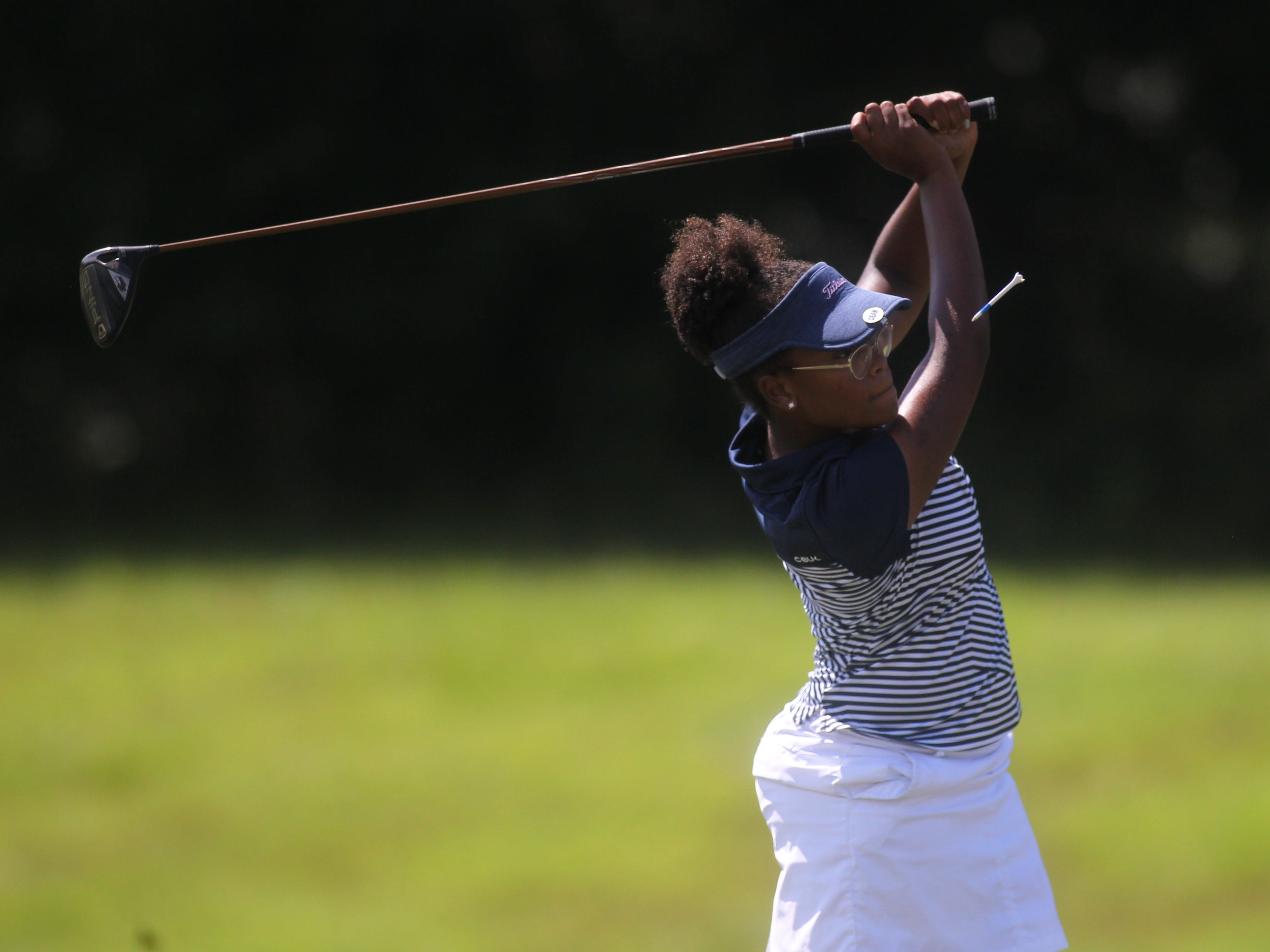 Maclay's Annika Dean watches a tee shot (literally) during a round at Southwood Golf Club.
