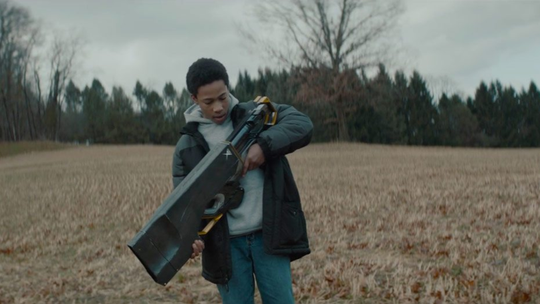 """Myles Truitt discovers a mysterious weapon in the sci-fi chase flick """"Kin,"""" which opens Friday."""