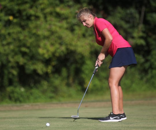 Franklin County senior golfer Melanie Collins putts during a round Monday at Wildwood Country Club.