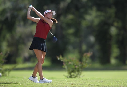 Chiles' Abby LaMothe watches a tee shot during a round at Wildwood Country Club.