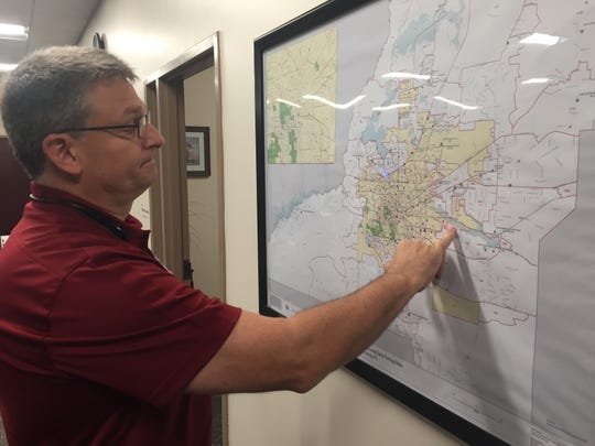 Leon County Supervisor of Elections Mark Earley surveys a precinct map just before polls opened Tuesday.