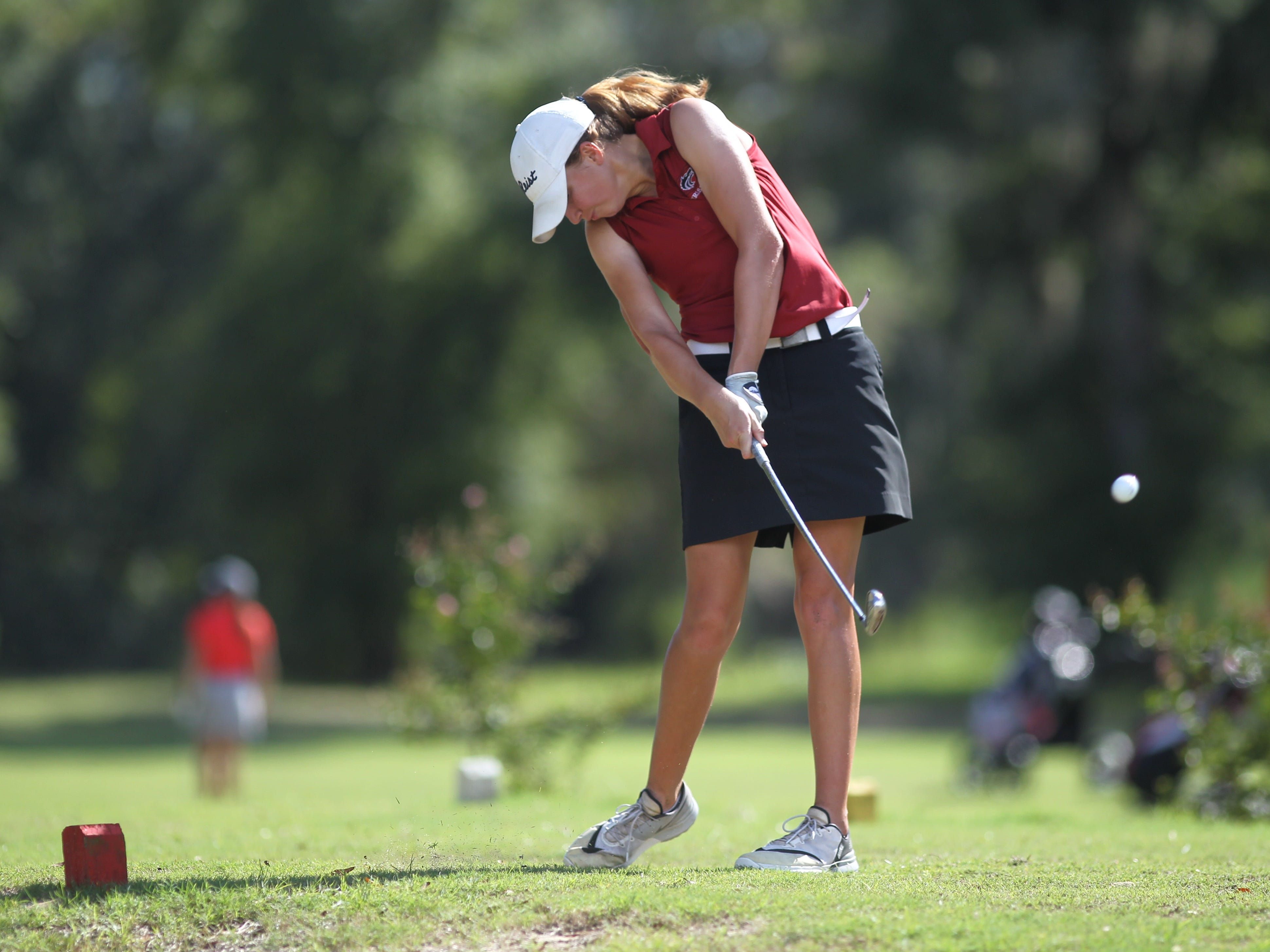Chiles senior golfer Mickela Helms tees off during a round Monday at Wildwood Country Club.
