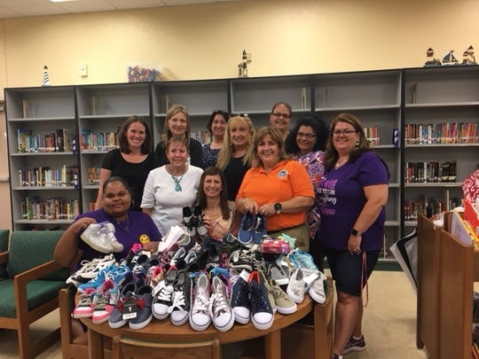 Kappa Kappa Iota, Alpha Beta Chapter of St. Lucie County educators collected shoes for St. Lucie County students.